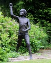 Boy throwing ball sculpture