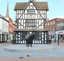Bronze Bull in front of Old House Hereford