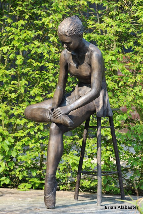 bronze of seated ballet dancer