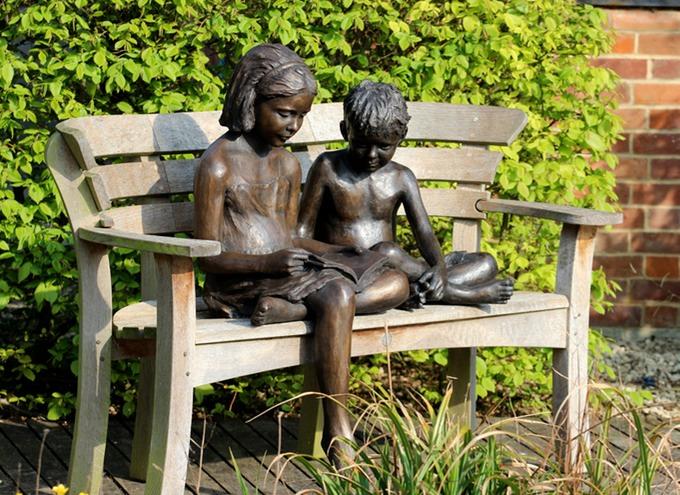 Bronze Sculpture Of Children Reading Brian Alabaster
