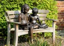 Bronze sculpture of children reading