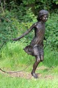 child skipping sculpture