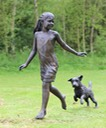 Girl running with terrier