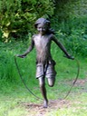 Girl skipping bronze