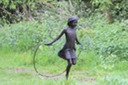 Girl skipping sculpture