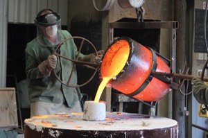 POURING BRONZE BULL SCULPTURE