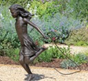 sculpture girl skipping