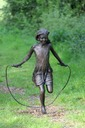 sculpture skipping girl bronze