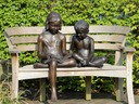 Seated sculpture of boy and girl
