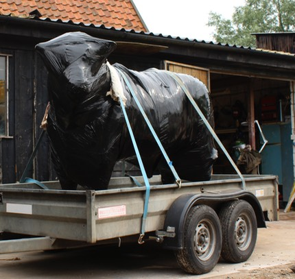 transprorting bronze bull sculpture